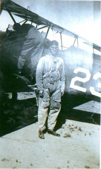 O. A. Labadie Jr. at March Field, CA in the late 1920s next to a Consolidated PT-3 Husky